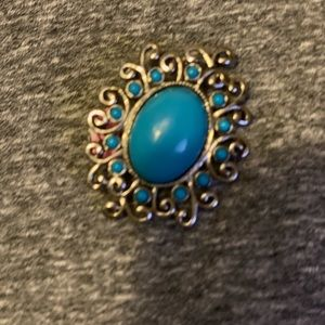 Brooch silver with turquoise color stone.